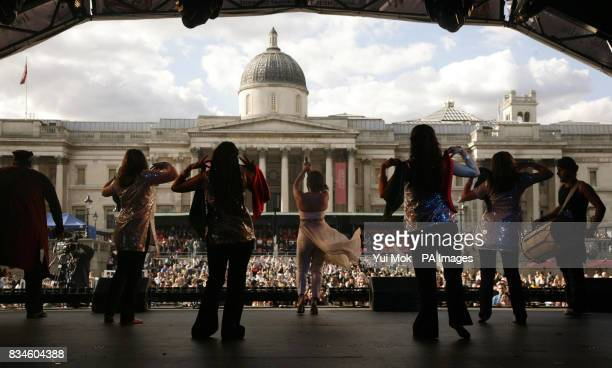 Bhangra singer Mona Singh performing on stage at the International Widows Day Concert in aid of The Loomba Trust in Trafalgar Square central London
