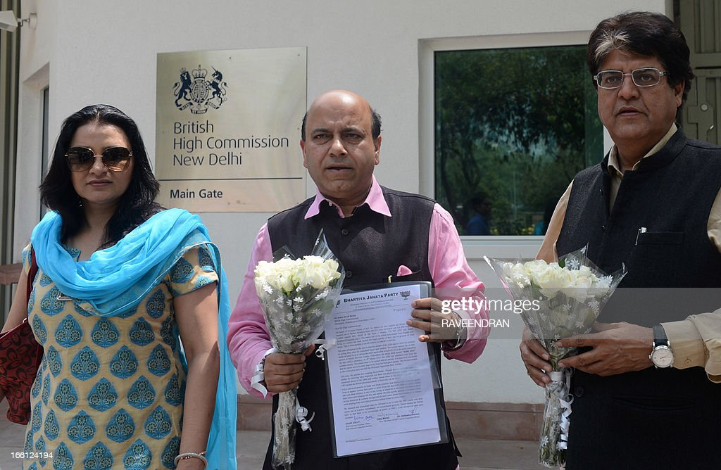 Bharathiya Janata Party (BJP) Convenor Overseas Affairs, Vijay Jolly (C) along with BJP members holds a letter prior to handing it over to the British High Commissioner in New Delhi on April 9, 2013. An Indian family living in Oxford is fighting to get their five-and-a-half-year-old son back from foster care after he was taken away by British social service officials on suspicion that he was being 'sexually abused and improperly touched' by his father.