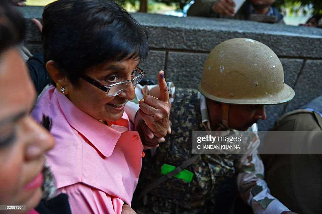 Bharatiya Janata Party (BJP) candidate for Delhi chief minister, <a gi-track='captionPersonalityLinkClicked' href=/galleries/search?phrase=Kiran+Bedi&family=editorial&specificpeople=2886102 ng-click='$event.stopPropagation()'>Kiran Bedi</a> shows her ink marked finger after casting her vote at a polling station in New Delhi on February 7, 2015. Voters went to the polls in India's capital with firebrand former chief minister Arvind Kejriwal looking to complete a surprise comeback and deliver the first major blow to Narendra Modi's premiership.