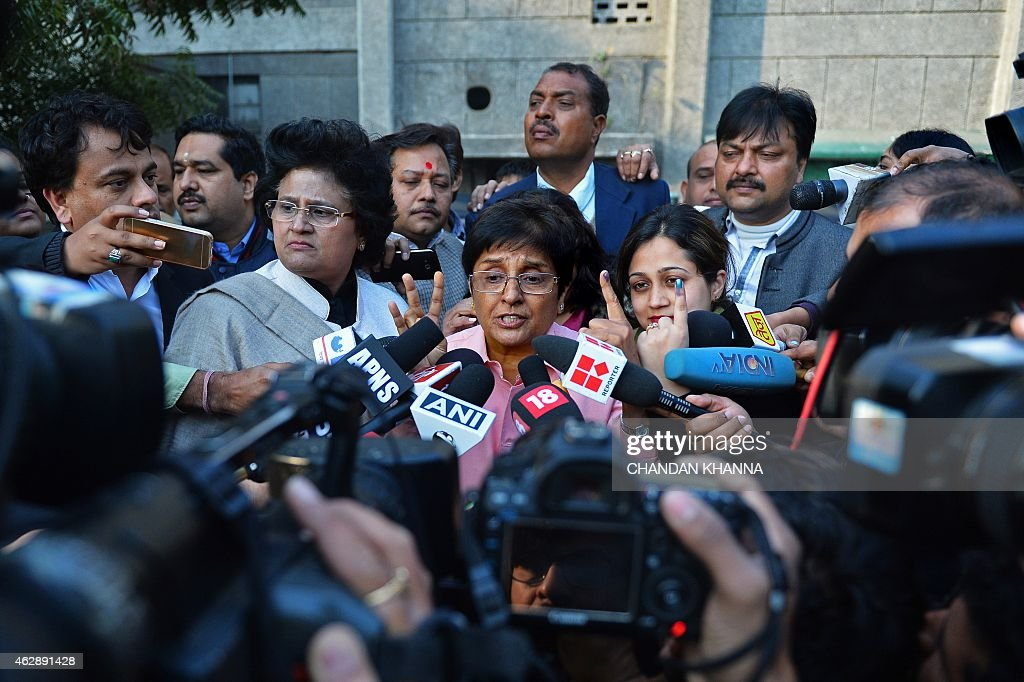Bharatiya Janata Party (BJP) candidate for Delhi chief minister, <a gi-track='captionPersonalityLinkClicked' href=/galleries/search?phrase=Kiran+Bedi&family=editorial&specificpeople=2886102 ng-click='$event.stopPropagation()'>Kiran Bedi</a> shows her ink marked finger as she speaks to the media after casting her vote at a polling station in New Delhi on February 7, 2015. Voters went to the polls in India's capital with firebrand former chief minister Arvind Kejriwal looking to complete a surprise comeback and deliver the first major blow to Narendra Modi's premiership.