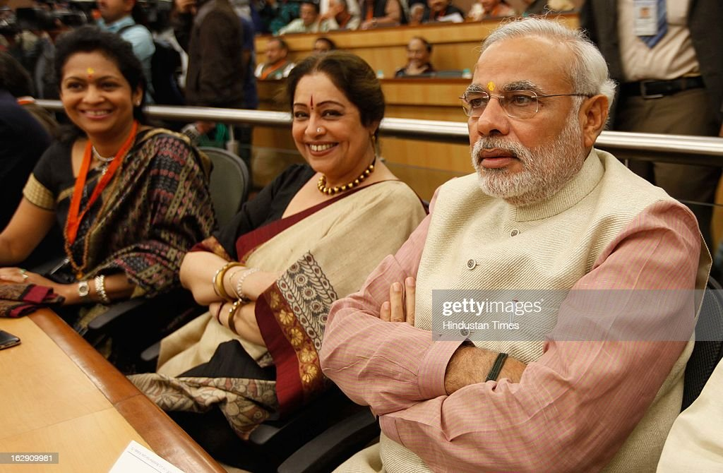 Bharatiya Janata Party leader and Gujrat Chief minister Narendra Damodardas Modi along with Kiran Kher during the Bharatiya Janata Party National convention at NDMC Convention Hall Near Jantar Mantar on March 1, 2013 in New Delhi, India. BJP leaders will discuss party's preparations with eye on the general elections and many assembly elections next one year.