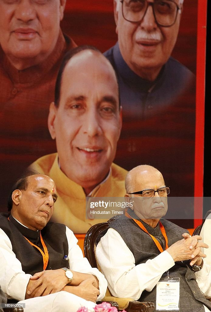Bharatiya Janata Party leader Rajnath Singh along with L.K Adavni, during the Bharatiya Janata Party National convention at NDMC Convention Hall Near Jantar Mantar on March 1, 2013 in New Delhi, India. BJP leaders will discuss party's preparations with eye on the general elections and many assembly elections next one year.