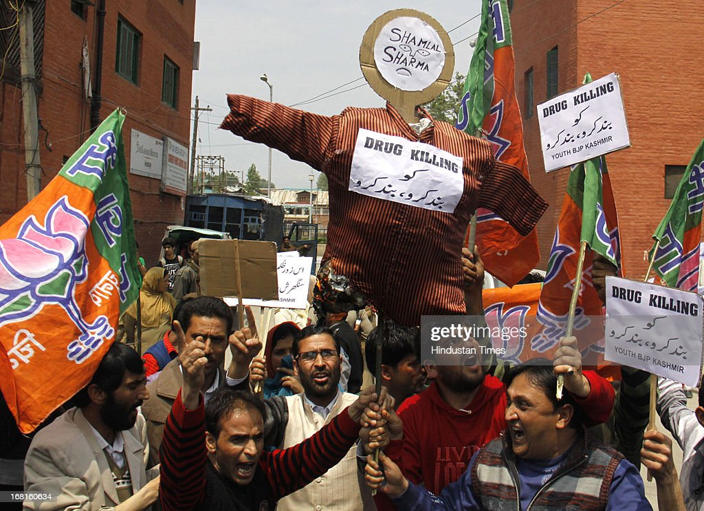 Bharatiya Janata Party leaders and workers holding the effigy of former J & K Health Minister Sham Lal Sharma, and shouts slogans during their protest against the supply of fake and spurious drugs to valley, at Lal Chowk on May 6, 2013 in Srinagar, India. Kashmir has been rocked by protests over the sale of spurious drugs. The scam came to light when laboratory tests revealed that an antibiotic supplied to various hospitals contained zero amount of Amoxycillin against the claimed 500 mg and other tests showed traces of particulate matter in some medicines.