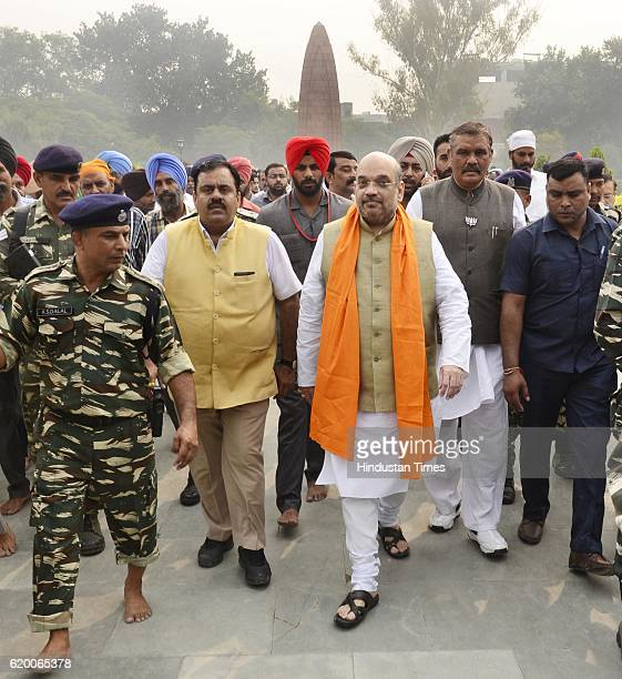 Bharatiya Janata Party National President Amit Shah along with BJP state Chief Vijay Sampla BJP National Secretary Tarun Chugh leaves after laying a...