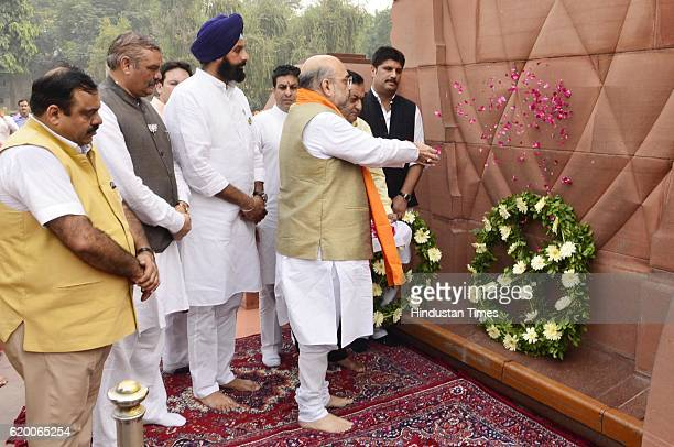 Bharatiya Janata Party National President Amit Shah throws flowers along with Punjab Revenue Minister Bikram Singh Majithia BJP state Chief Vijay...