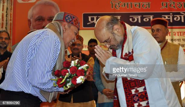 Bharatiya Janata Party President Amit Shah honouring Dr NK Kalia father of first martyr of Kargil war Lieutenant colonel Sourabh Kalia during the...