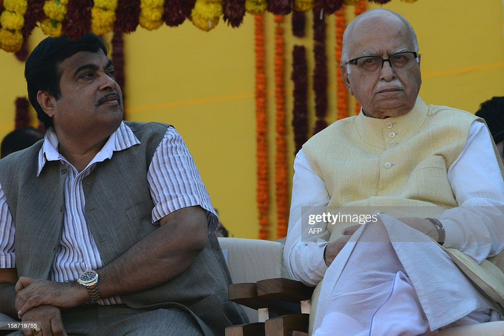 Bharatiya Janata Party (BJP) president Nitin Gadkari (L) and senior BJP leader L K Advani look on during the swearing in ceremony of Chief Minister of the western Indian state of Gujarat Narendra Modi at The Sardar Patel Navrangpura Stadium in Ahmedabad on December 26, 2012. Modi who won a landslide victory in recent state assembly polls, was administered the oath of office and secrecy by Gujarat Governor Kamla Beniwal at a ceremony which was attended by many senior BJP leaders. AFP PHOTO/Sam PANTHAKY