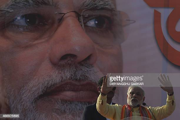 Bharatiya Janata Party prime ministerial candidate and India's Gujarat state Chief Minister Narendra Modi delivers his speech during a mass rally in...