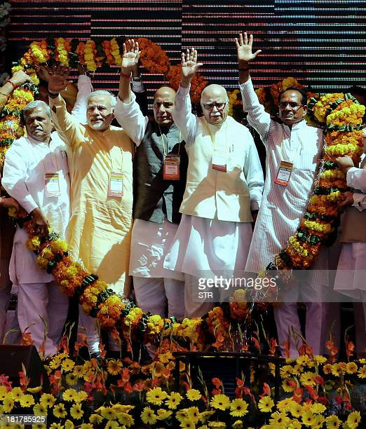 Bharatiya Janata Party prime ministerial candidate Narendra Modi senior leader L K Advani national president Rajnath Singh Madhya Pradesh chief...