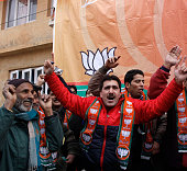 Bharatiya Janata Party supporters dance to celebrate their victory in the Jammu and Kashmir Assembly elections at party Headquarters on December 24...