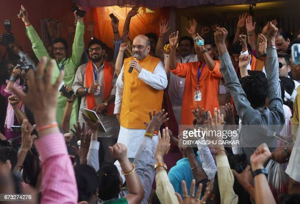 Bharatiya Janta Party national president Amit Shah addresses BJP party workers' home in a slum area in West Bengal Chief Minister Mamata Banerjee's...