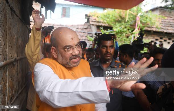 Bharatiya Janta Party national president Amit Shah gestures as he visits BJP party workers' home in a slum area in West Bengal Chief Minister Mamata...