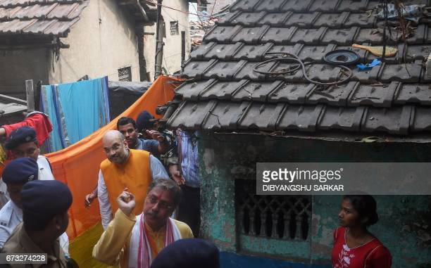 Bharatiya Janta Party national president Amit Shah visits BJP party workers' home in a slum area in West Bengal Chief Minister Mamata Banerjee's...