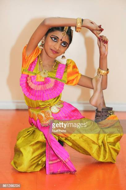 Bharatnatyam dancer practices an expressive dance backstage before a performance at a Tamil Hindu temple in Ontario Canada