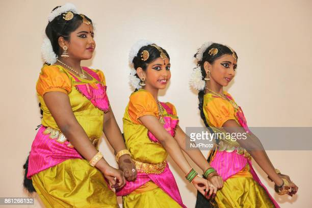 Bharatnatyam dancers practice an expressive dance backstage before a performance at a Tamil Hindu temple in Ontario Canada