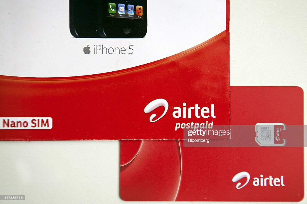 Bharti Airtel Ltd. SIM card and brochure are displayed for a photograph at the company's flagship store in Mumbai, India on Thursday, May 2, 2013. Bharti Airtel, India's largest mobile-phone operator, posted profit that missed analyst estimates after a weaker rupee raised the interest payments and prices for network equipment. Photographer: Kuni Takahashi/Bloomberg via Getty Images