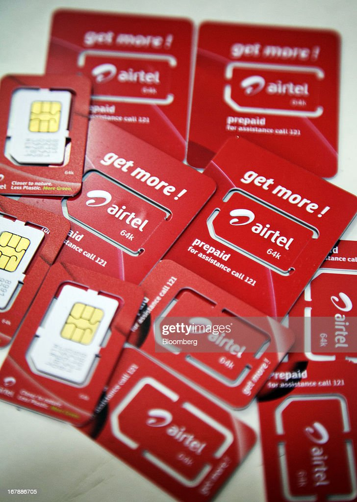 Bharti Airtel Ltd. SIM cards are displayed for a photograph at the company's flagship store in Mumbai, India on Thursday, May 2, 2013. Bharti Airtel, India's largest mobile-phone operator, posted profit that missed analyst estimates after a weaker rupee raised the interest payments and prices for network equipment. Photographer: Kuni Takahashi/Bloomberg via Getty Images