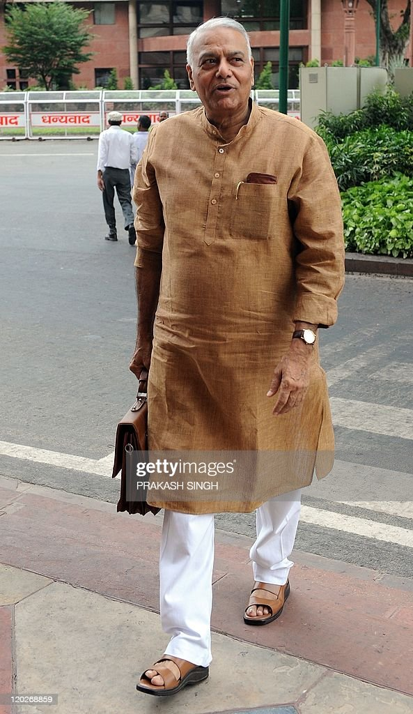 Bhartiya Janata Party (BJP) Leader and former finance minister Yashwant Sinha arrives for the Monsoon Parliamentary Session in New Delhi on August 3, 2011. As inflation continues to soar unchecked, the UPA has shed its diffidence and accepted the Opposition's demand to discuss the issue of price rise in the parliament under a rule that entails voting at the end of the debate. Parliament's 39-day monsoon session is slated to debate or approve 32 new laws including the hard-fought Lokpal Bill, which if passed will arm a national ombudsman with powers to punish corrupt politicians and officials. AFP PHOTO/Prakash SINGH