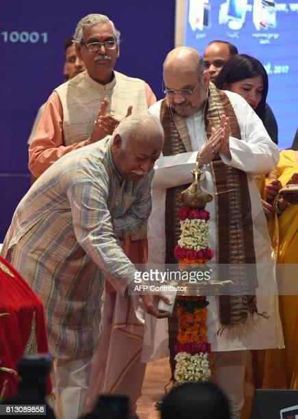 Bhartiya Janata Party President Amit Shah and Mohan Bhagwat chief of the Hindu nationalist organisation Rashtriya Swayamsevak Sangh light a lamp...