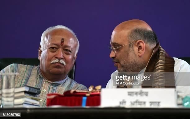 Bhartiya Janata Party President Amit Shah talks with Mohan Bhagwat chief of the Hindu nationalist organisation Rashtriya Swayamsevak Sangh during a...