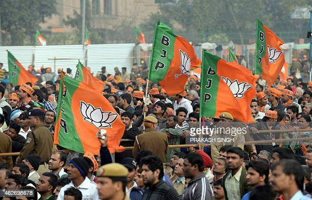 Bhartiya Janata Party supporters listen to Indian Prime Minister Narendra Modi during a public rally in New Delhi on February 3 2015 Indian Prime...