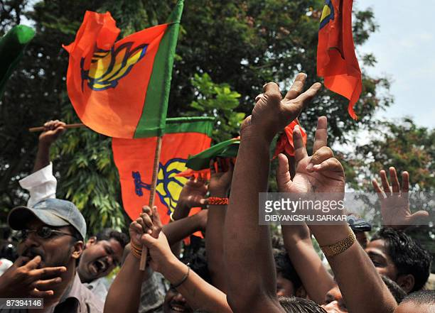 Bhartiya Janata Party supporters wave party flags as they celebrate the win of their party candidate in the Bangalore South seat in Bangalore on May...