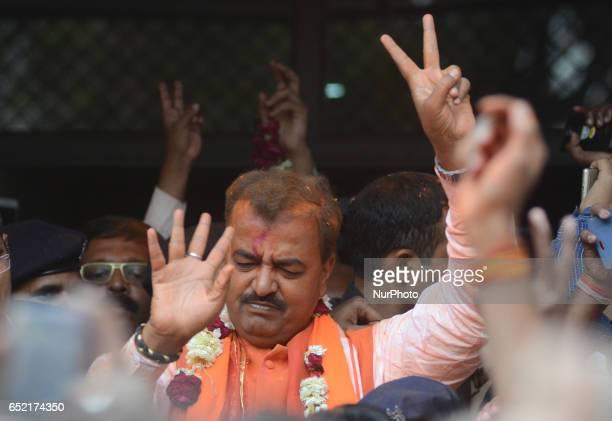Bhartiya Janta Party President of Uttar Pradesh Keshav Prasad maurya shows victory sign after election results outside the party state head quarter...