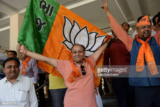 Bhartiya Janta Party supporters celebrate as they assemble at 'Kamalam' Koba near Gandhinagar some 20 kms from Ahmedabad on March 11 2017 Prime...