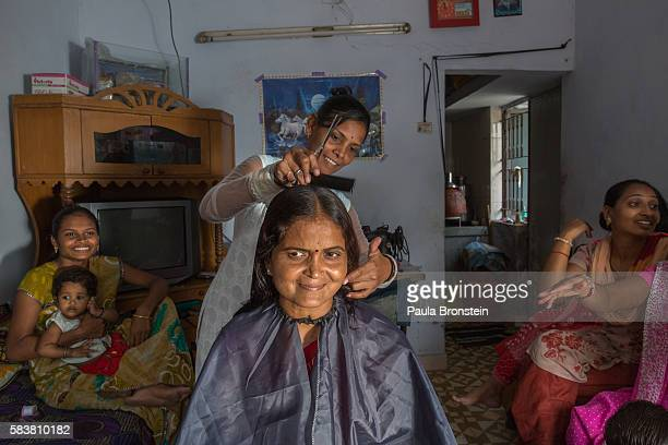 Bhavna Headod is a home based worker who has a beauty parlor She is cutting the hair of Indira Ramaranj She took a micro loan for the parlor from...