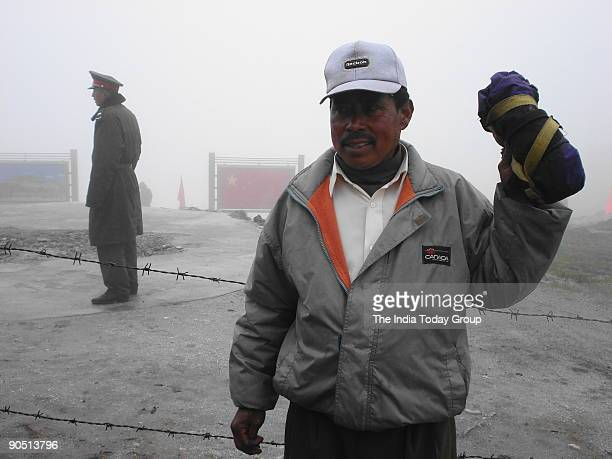 Bhim Bahadur Tamang and a Chinese soldier near wire on the border fence at Nathu La Trade between India and China is set to begin as the 14000ft high...
