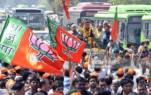 Bhojpuri actor Manoj Tiwari along with Rajya Sabha MP Vijay Goel and his supporters goes to file his nomination papers from North East Delhi...