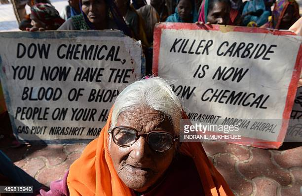 Bhopal Gas disaster victim Pujarbai who has lost her eyesight attends a protest rally in Bhopal on December 2 2014 The Bhopal industrial disaster the...