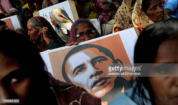 Bhopal Gas survivors hold placards and shout slogans during a protest in New Delhi on November 8 2010 urging US President Barack Obama to hold US...