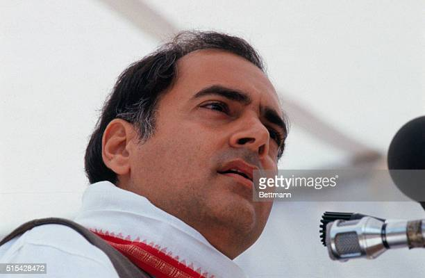 Rajiv Gandhi sits on a platform during a rally held in the city of Bhopal India The city was recently the stage for the worst industrial accident in...