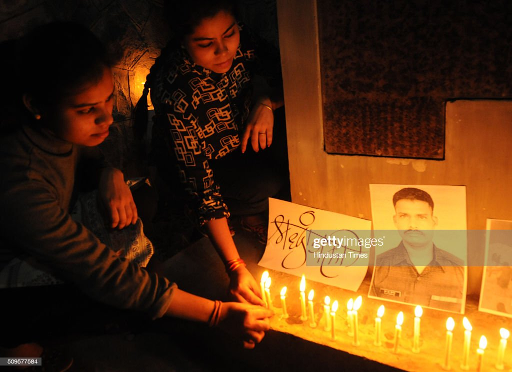 Bhopal residents light candles to mourn the death of Siachen survivor Lance Naik Hanamanthappa Koppad at Shaurya Smarak on February 11, 2016 in Bhopal, India. Lance Naik Hanamanthappa Koppad of 19 Madras Regiment was rescued alive on night after being buried under 35 feet of snow for six days. The lone survivor of the February 3 Siachen avalanche that claimed the lives of nine soldiers, breathed his last at the Army RR Hospital in Delhi.