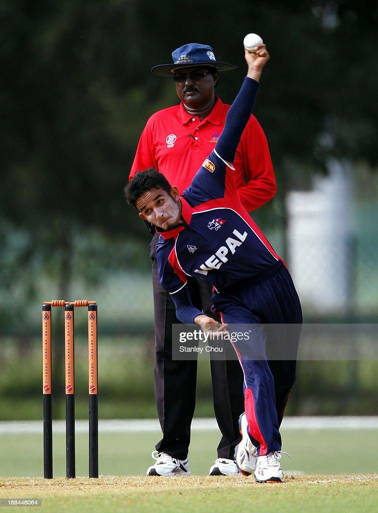 Bhuban Karki of Nepal bowls during the ACC U-19 Elite Cup Semi Final against UAE at the Bayuemas Cricket Ground on May 10, 2013 in Kuala Lumpur, Malaysia.