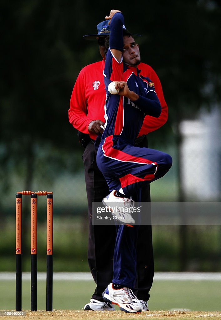 Bhuban Karki of Nepal bowls during the ACC U-19 Elite Cup Semi Final against UAE at the Bayuemas Cricket Ground on May 10, 2013 in Kuala Lumpur, Malaysia.
