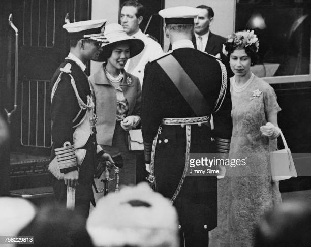 Bhumibol Adulyadej King of Thailand and Queen Sirikit are greeted by Queen Elizabeth and Prince Philip at Victoria Station London at the start of a...