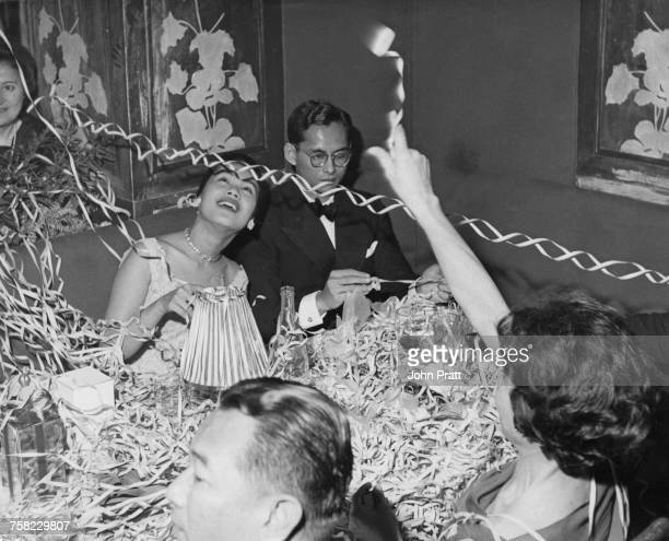 Bhumibol Adulyadej King of Thailand and Queen Sirikit celebrate the new year at the Palace Hotel in Gstaad Switzerland where they are on holiday with...