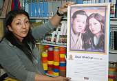 THIMPHU Bhutan A woman in a stationery shop in Thimphu the capital of Bhutan shows a calendar marking the wedding of the country's king Jigme Khesar...