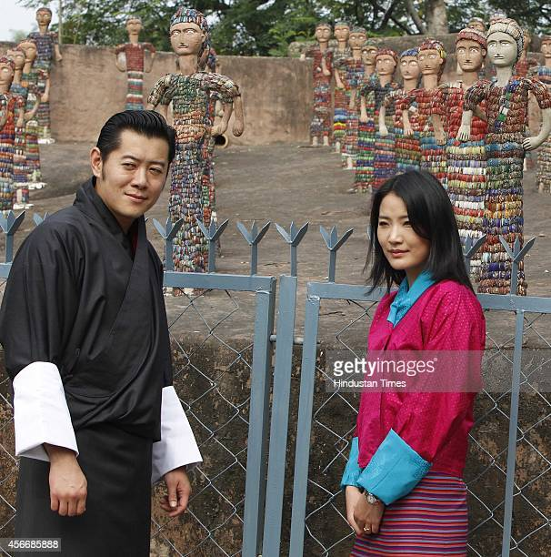 Bhutan King Jigme Khesar Namgyel Wangchuck and his wife Jetsun Pema Wangchuck at Rock Garden on October 5 2014 in Chandigarh India During his visit...