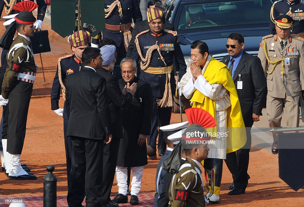 Bhutan King Jigme Khesar Namgyel Wangchuk (CR) and Indian president Pranab Mukherjee (CL) arrive for the Republic Day parade in New Delhi on January 26, 2013. India marked its Republic Day with celebrations held under heavy security, especially in New Delhi where large areas were sealed off for an annual parade of military hardware at which Bhutan's king Jigme Khesar Namgyel Wangchuck was chief guest.