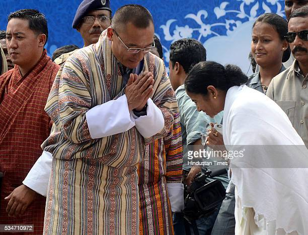 Bhutan Prime Minister Tshering Tobgay bids adieu to West Bengal Chief Minister Mamata Banerjee after her oath taking ceremony on May 27 2016 in...