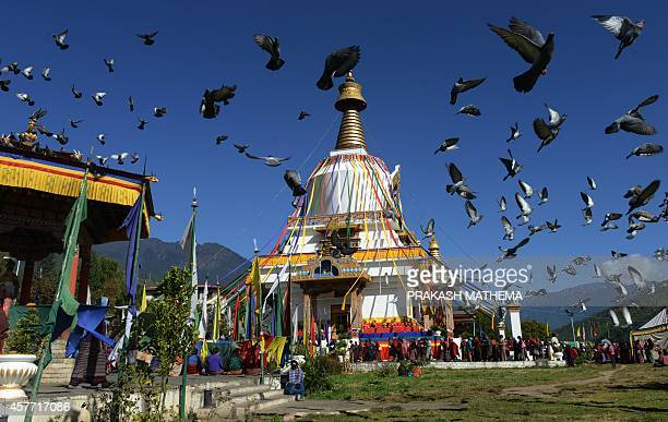Bhutanese Buddhist devotees walk near the Memorial Chorten Monastery during a annual Drupchhen ritual inThimphu on October 23 2014 Bhutan nestled in...