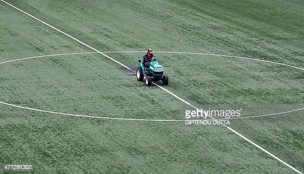A Bhutanese groundstaff member works on the pitch at The Changlimithang Stadium in Thimphu on June 15 ahead of Bhutan's Asia group C FIFA World cup...