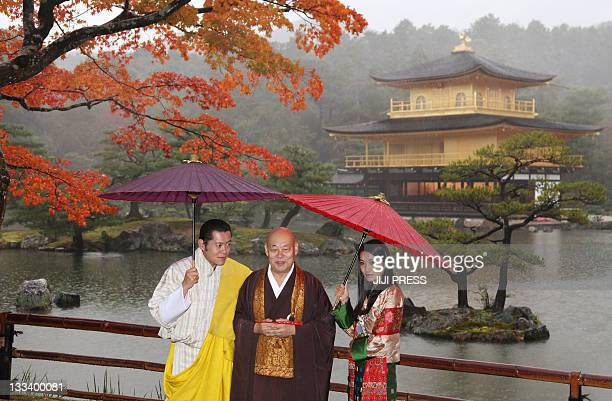 Bhutanese King Jigme Khesar Namgyel Wangchuck Queen Jetsun Pema and Chief Priest Raitei Arima pose for a photograph during the couple's visit to...