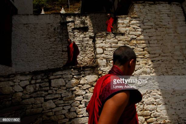 JAKAR BHUMTANG Bhutanese monks take a break from morning studies in the 8th century Kurjey Lhakang Monastery in Jakar in the province of Bhumthang...