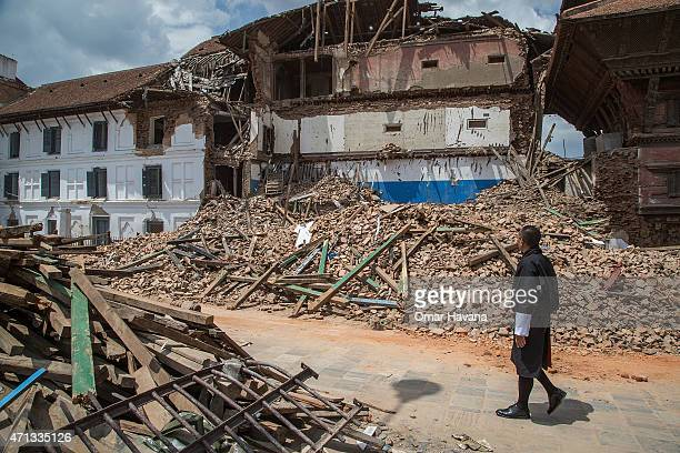 Bhutanese Prime Minister Tshering Tobgay walks by one of the collapsed temples at Basantapur Durbar Square on April 27 2015 in Kathmandu Nepal A...