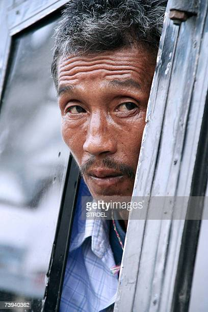 Bhutanese refugee Sitaram waits in a bus after a protest rally organized by the National Front for Democracy Bhutan at Mechi River Bridge on the...