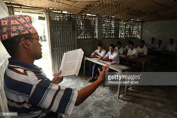 A Bhutanese refugee takes a class of students at The Oasis Academy at The Timai Refugee Camp some 300kms southeast of Kathmandu on October 8 2009...